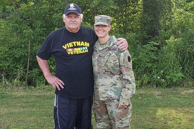 John Schilinski and his daughter, Army Staff Sgt. Rachel Kovach, a squad leader with the Pennsylvania Army National Guard's 2nd Platoon, Alpha Company, 1st Battalion, 112th Infantry Regiment, strengthened their family ties when Kovach became an infantry soldier. (Pennsylvania Army National Guard photo/Gregory McElwain)