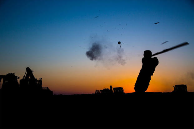U.S. Army Pfc. Michael Gilreath, 3rd Cavalry Regiment, swings an improvised bat during a fun game of baseball near the Iraqi-Syrian border, June 23, 2018. (U.S. Army/Spc. Anthony Zendejas IV)