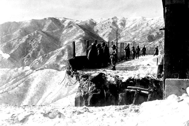 This blown bridge blocked the only way out for U.S. forces withdrawing from Chosin Reservoir. Air Force C-119s dropped portable bridge sections to span the chasm, allowing men and equipment to reach safety. (U.S. Air Force photo)