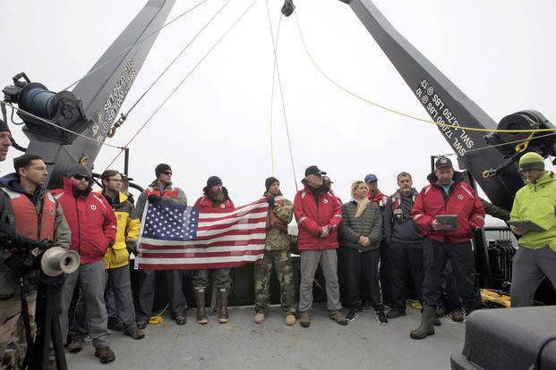 The project team and members of the crew of the R/V Norseman II conduct a wreath ceremony to honor the final resting place of the 71 Sailors lost on the USS Abner Read. (Image courtesy of Kiska: Alaska's Underwater Battlefield expedition)