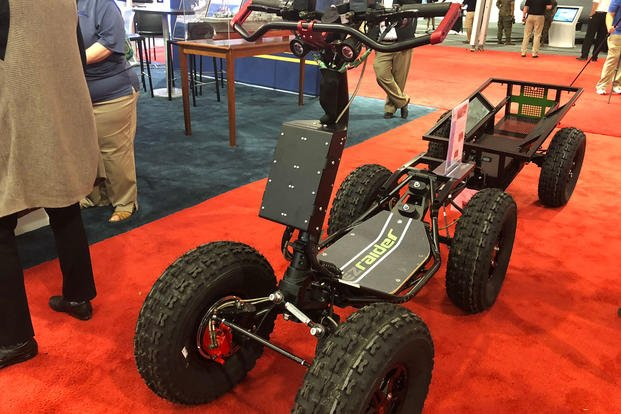 The DS EZ Raider is an all-electric scooter that can operate in any terrain and tandem-jump with troops out of aircraft. (Military.com/Hope Hodge Seck)