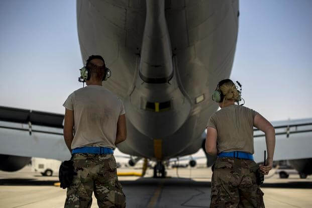U.S. Air Force KC-135 Stratotanker maintainer assigned to the 28th Expeditionary Air Refueling Squadron at Al Udeid Air Base, Qatar, inspect the flaps on the wings prior to the engine start Sept. 1, 2018. (U.S. Air Force/Senior Airman Xavier Navarro)