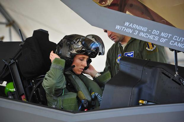 Lt. Col. Christine Mau, the 33rd Operations Group deputy commander, puts on her helmet before taking her first flight in the F-35A Lightning II at Eglin Air Force Base, Fla., on May 5, 2015. Mau, who previously flew F-15E Strike Eagles, made history as the first female F-35 pilot in the program. (U.S. Air Force photo/Staff Sgt. Marleah Robertson)