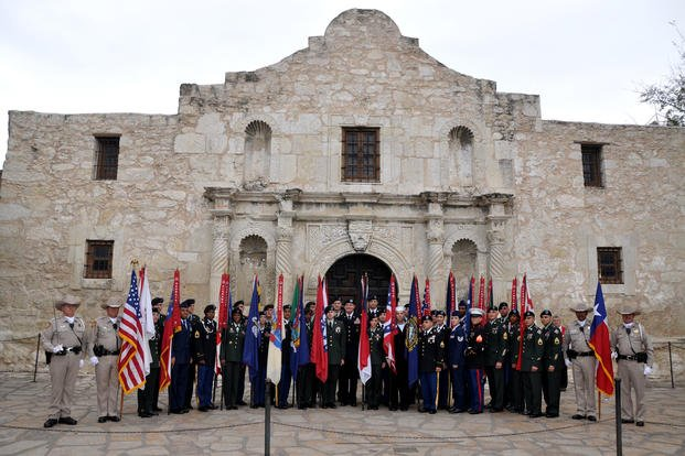 Thirty service members, representing the Army, Navy, Marine Corps and Air Force stand before The Alamo on March 6, 2010, commemorating the battle that took place there in February and March of 1836 for Texan independence from Mexico. (US Army photo/Esther Garcia)