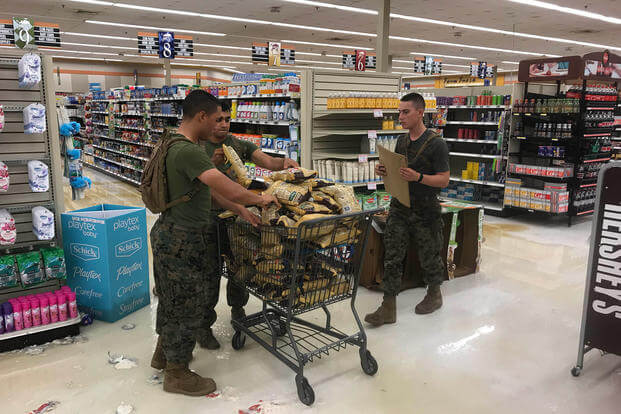 Marines help salvage products at the Camp Lejeune, North Carolina commissary after Hurricane Florence. (Marine Corps/Brian Ehrlich)