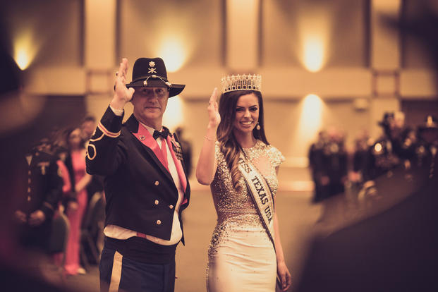 Logan Lester, Miss Texas, USA and Lt. Col Joey Errington, 3-16th FA commander, takes part in the Order of Saint Barbara awards ceremony during 3-16th FA's Battalion Ball. (U.S. Army/Carson Petry).