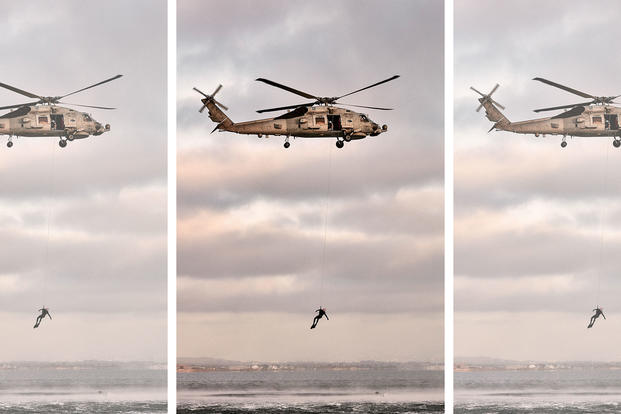 Navy helicopter and diver