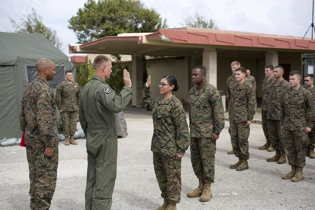 U.S. Marine Corps Lance Cpl. Remedios Cruz, Marine Aircraft Group 12, recites the Oath of Enlistment after being meritoriously promoted at Anderson AFB, Guam, 4 Dec. 2013. (U.S. Marine/Lance Cpl. Richard Currier)