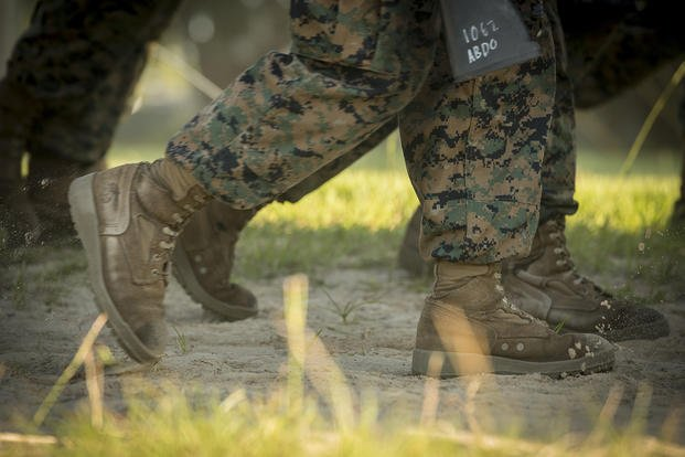 U.S. Marine Corps recruits of Bravo Company, 1st Recruit Training Battalion, march during a six-mile conditioning hike on Parris Island, South Carolina. In an effort to continually improve the clothing and equipment Marines are issued, Marine Corps Systems Command will conduct an assessment to see if lighter boots can improve recruit performance. Plans are to compare two lighter boots to the Marine Corps Combat Boot during a recruit training cycle at Parris Island. (Joseph Jacob/Marine Corps)