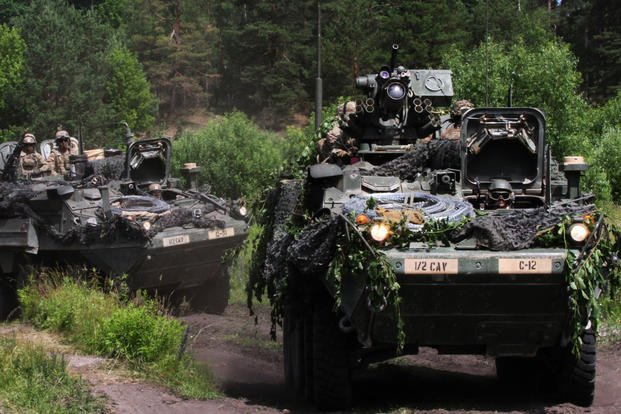 A Stryker from the 2nd Cavalry Regiment fitted with the Common Remotely Operated Weapon Station-Javelin negotiates the terrain of the Hohenfels Training Area, Germany. (U.S. Army photo)