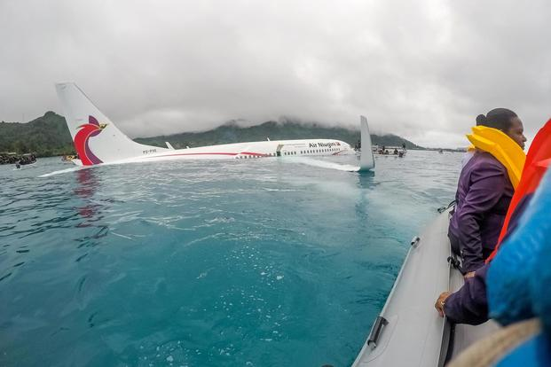 U.S. Sailors assigned to Underwater Construction Team (UCT) 2 assist in rescuing the passengers and crew of Air Niugini flight PX56 following the plane ditching into the sea on its approach to Chuuk International Airport in the Federated States of Micronesia, Sept. 28, 2018. (U.S. Navy /Lt. Zach Niezgodski)