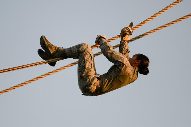 U.S. Air Force Staff Sgt. Jan Marie Csady, 97th Security Forces Squadron airman, descends a rope obstacle during the Air Education and Training Command's Defender Challenge team selection July 23, 2018, at Joint Base San Antonio-Camp Bullis, Texas. Defender Challenge is a Security Forces competition that pits teams against each other in realistic weapons, dismounted operations and relay challenge events. (U.S. Air Force photo by Sean M. Worrell)