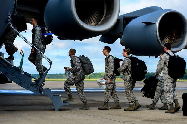 Airmen board a C-17 Globemaster September 2014. (US Air Force/Kayla Newman)