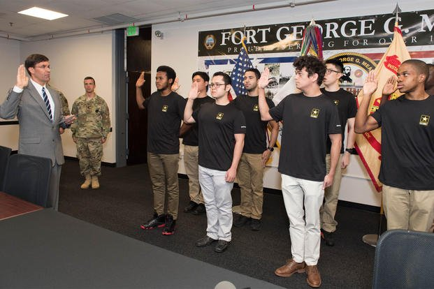 Secretary of the Army Dr. Mark T. Esper swears in new recruits at the Baltimore MEPS station at Fort George G. Meade. (Photo: Staff Sgt. Brandy N. Mejia, US Army)