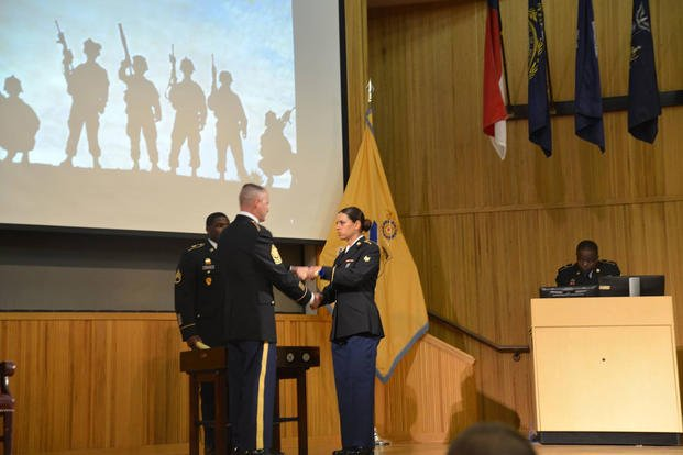 U.S Army Cpl. Hala Kadhem, a unit supply specialist assigned to the 2nd Infantry Brigade Combat Team, 4th Infantry Division, receives her diploma after graduating from Advanced Individual Training at Fort Lee, Virginia, November 1, 2018. (Courtesy photo)