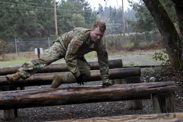 A Soldier assigned to the 189th Combined Arms Training Brigade hurls over an obstacle during the Brigade's Best Captain Competition on Joint Base Lewis-McChord, Wash., April 4, 2018. (U.S. Army/SSG Eliverto V Larios)