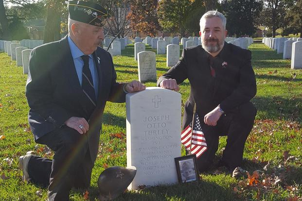 Dennis Anderson (left) and Garrett Anderson (right) at the gravestone of WWI soldier Pvt. Joseph Otto Turley, at Arlington National Cemetery, November 11, 2018. (Richard Sisk/Military.com)