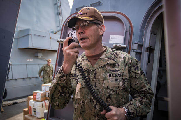 Vice Adm. Scott Stearney, commander of U.S. Naval Forces Central Command, U.S. 5th Fleet and Combined Maritime Forces, speaks Oct. 24, 2018 on the 1MC shipboard intercom to welcome the crew of the guided-missile destroyer USS Jason Dunham (DDG 109) to Manama, Bahrain.  (U.S. Navy/ Jonathan Clay)