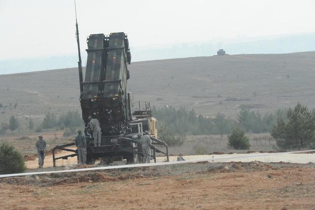 U.S. soldiers with the 3rd Battalion, 2nd Air Defense Artillery Regiment perform maintenance on Patriot missile launchers Feb. 5, 2013, in Gaziantep, Turkey. (U.S. Army/Capt. Royal Reff)