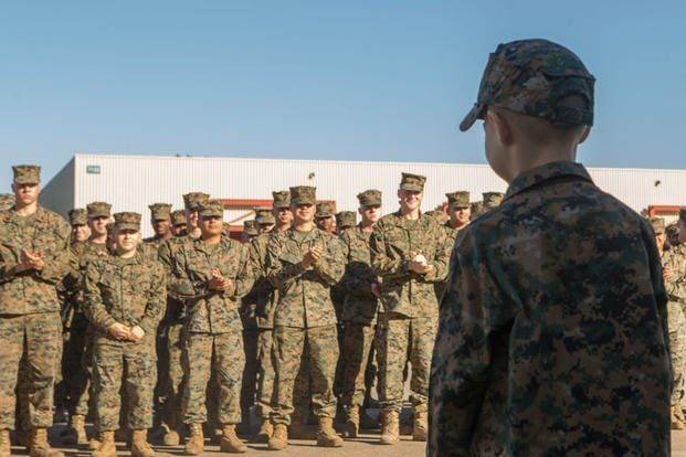 The Marines of Marine Wing Communication Squadron (MWCS) 38, 3rd Marine Aircraft Wing (MAW) applaud Alec J. Rubio, after he is appointed as an honorary Marine at Marine Corps Air Station Miramar, Calif., Dec. 19. Rubio, who was diagnosed with Adrenoleukodystrophy (ALD), a terminal illness, was awarded the title Honorary Marine by the Marines of MWCS-38, Marine Air Control Group (MACG) 38, 3rd MAW. (U.S. Marine Corps photo/Levi J. Guerra)