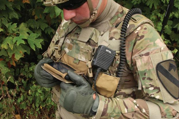 Soldier checks out his smartphone. (Photo Credit: PEO Soldier)