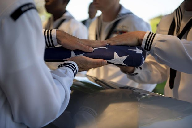 Sailors assigned to Navy Region Hawaii fold the American flag over the remains of U.S. Navy F1c Grant Clark COOK Jr. at the National Memorial Cemetery of the Pacific, Honolulu, Hawaii, May. 09, 2019.  (Jamarius Fortson/U.S. Army)