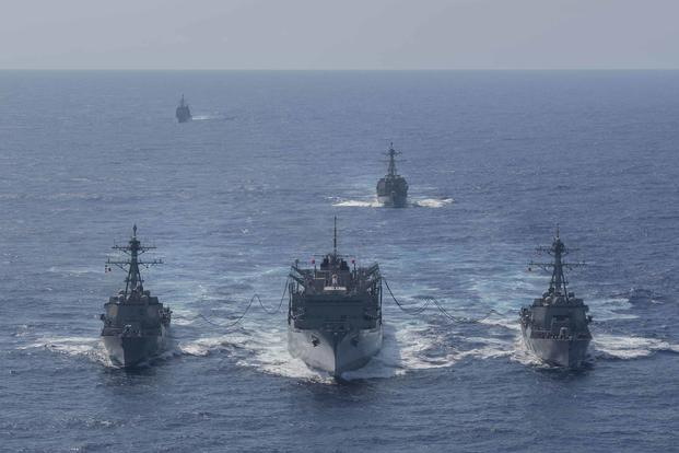 From left to right, the guided-missile destroyer Forrest Sherman (DDG 98), the fast combat support ship USNS Supply (T-AOE 6), and the guided-missile destroyer Gravely (DDG 107) conduct a refueling-at sea, while the guided-missile cruiser Normandy (CG 60) (far left) and guided-missile destroyer Winston S. Churchill (DDG 81) (center right) stand-by in the Atlantic Ocean onSept. 7, 2019. (U.S. Navy photo by Mass Communication Specialist 3rd Class Rebekah M. Rinckey)