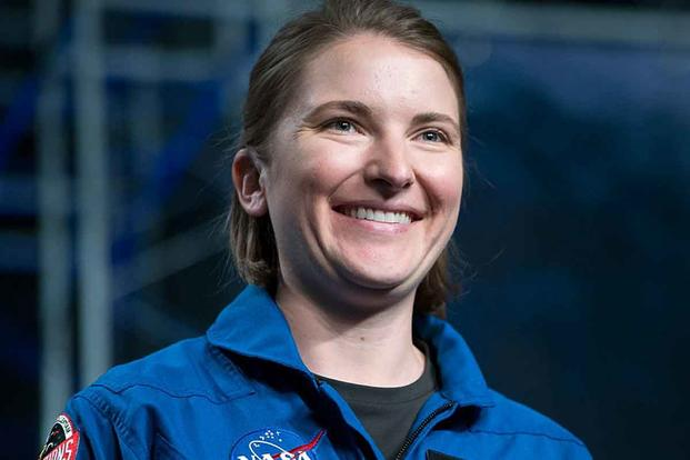 Navy Lt. Kayla Barron is shown being introduced as one of 12 new astronaut candidates during an event at NASA's Johnson Space Center in Houston in 2017. Navy photo