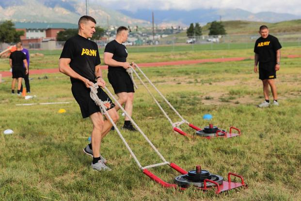 U.S Army Sgt. 1st Class James Nichols and another NCO drag a 90-pound sled, Aug. 27, 2019, during the sprint-drag-carry station of the Army Combat Fitness Test on Fort Carson, Colorado. (U.S. Army/Staff Sgt. Neysa Canfield)