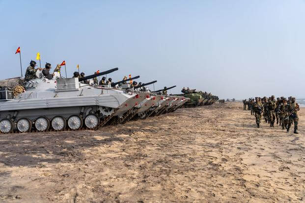 U.S. Marines and Indian soldiers prepare to depart Kakinada, India at the conclusion of exercise Tiger TRIUMPH, Nov. 21, 2019. During Tiger TRIUMPH, U.S. and Indian forces conducted valuable training in humanitarian assistance disaster relief operations by inserting a joint and combined Indian and U.S. force from ship-to-shore in response to a hypothetical natural disaster. While on shore, the forces conducted limited patrolling, moved simulated victims to medical care and produced and distributed drinking