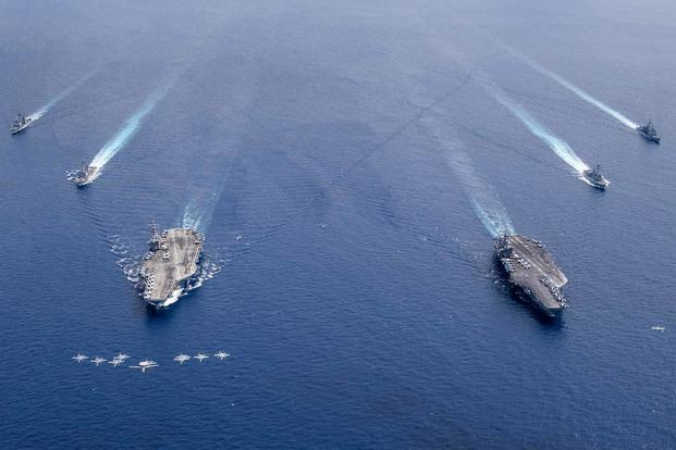 The aircraft carriers USS Nimitz and USS Ronald Reagan and their carrier strike groups.