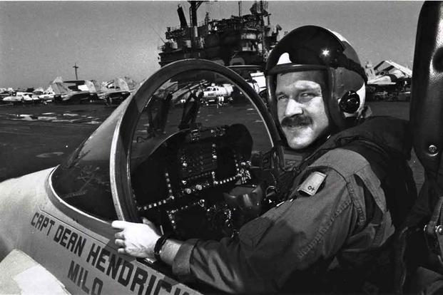 Mark Fox poses in a Hornet aboard the USS Saratoga.