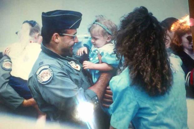 Rodriguez greets his wife, Trish, and his daughter, Amanda.