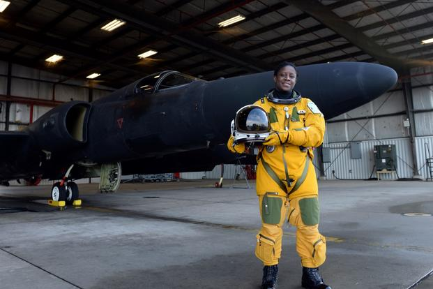 Lt. Col. Merryl Tengesdal stands in front of a U-2 at Beale Air Force Base.