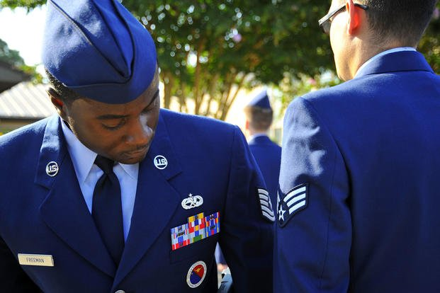 U.S. Air Force staff sergeant inspects uniform