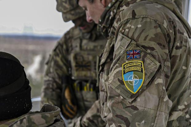British soldiers evaluate coordinates at the Tapa Training Grounds, Estonia.