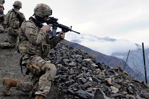 Capt. Craig Giese scans the horizon for possible threats in Afghanistan.