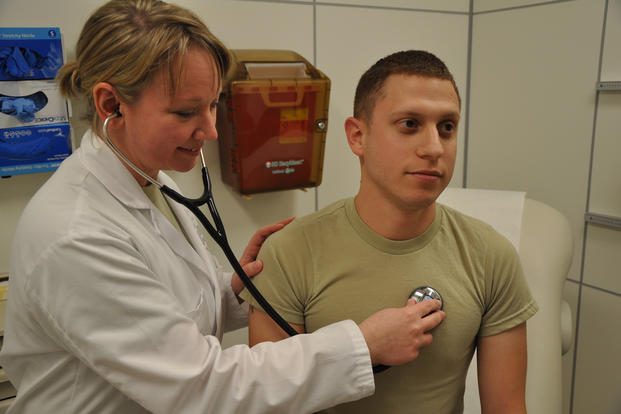 doctor gives physical examination