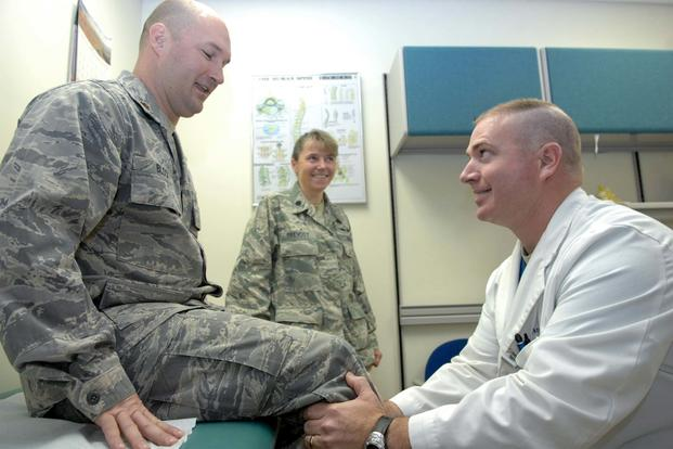 FILE – A doctor examines a patient while another doctor oversees the procedure, at Elmendorf Air Force Base, Alaska. (U.S. Air Force photo/Airman Jack Sanders)