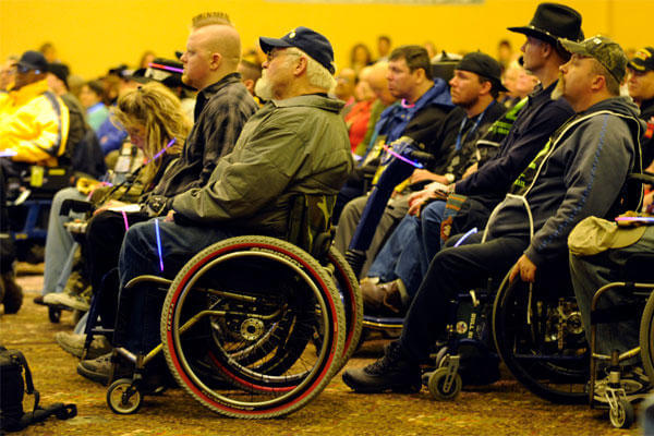 Veterans attend the opening ceremony inside The Silver Tree Hotel March 29 for the 23rd National Disabled American Veterans Winter Sports Clinic in Snowmass Village, Colo. (U.S. Air Force photo/Staff Sgt. Desiree N. Palacios)