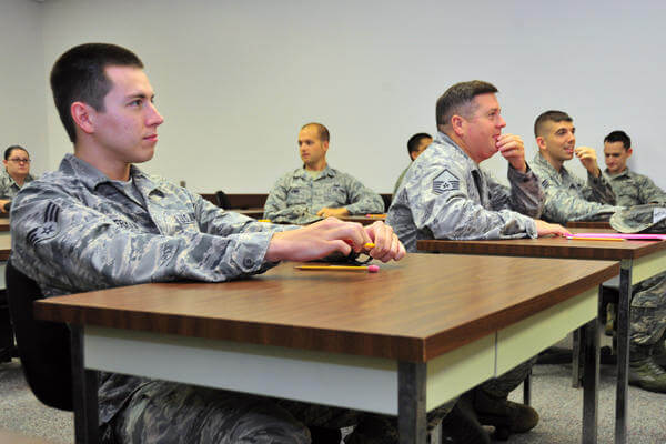 Airmen taking tests at their desks in a class.
