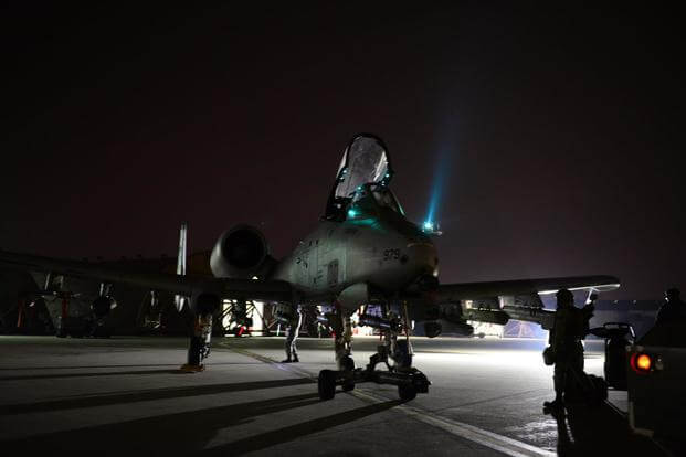 Members of the 25th Fighter Squadron ready A-10 Thunderbolt IIs for night operations during the first night of the exercise Vigilant Ace 16 at Osan Air Base, Republic of Korea, Nov. 2, 2015. (U.S. Air Force photo by Amber Grimm)