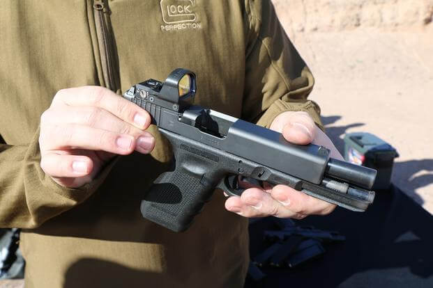 Kyle Hopp, commercial manager for Glock, shows off the company's new Modular Optic System, or MOS, Jan. 18, 2016, at SHOT Show's range day outside Las Vegas. (Photo by Brendan McGarry/Military.com)