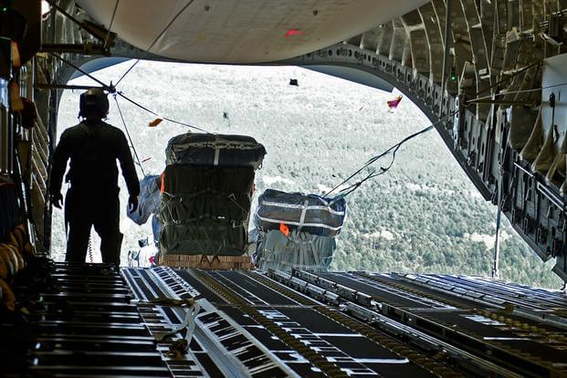 Cargo for the 82nd Airborne Division is air-dropped out the back of a C-17 Globemaster III, Oct. 29, 2015, over North Carolina, during a Joint Operation Access Exercise. (Photo by Divine Cox/U.S. Air Force)