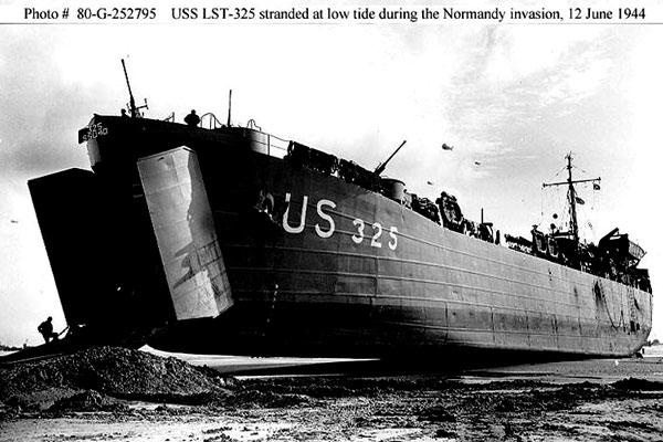 June 12, 1944: The U.S. Navy's LST 325 sits on Normandy Beach at low tide. Ernie Andrus has just run across America to raise money for it. (US Navy photo)