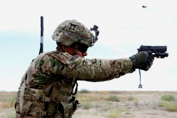 A 101st Airborne Division soldier fires a Sig Sauer pistol during weapons training on May 29, 2015 at Tactical Base Gamberi in eastern Afghanistan. (U.S. Army photo/Charlie Emmons)