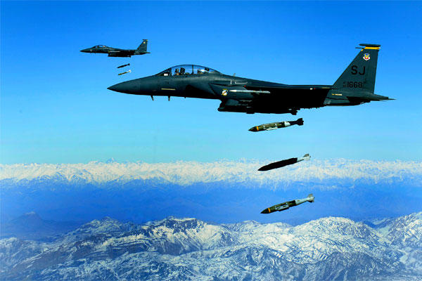 U.S. Air Force F-15E Strike Eagles drop 2,000-pound Joint Direct Attack Munitions on a cave in eastern Afghanistan in November 2009. (US Air Force photo/Michael Keller)