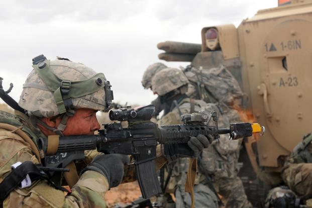 A soldier assigned to 1st Battalion, 6th Infantry Regiment, 2nd Brigade Combat Team, 1st Armored Division, fires a M4 carbine weapon during urban warfare training May 22, 2017, at Orogrande, N.M. Staff Sgt. Elizabeth Tarr/Army