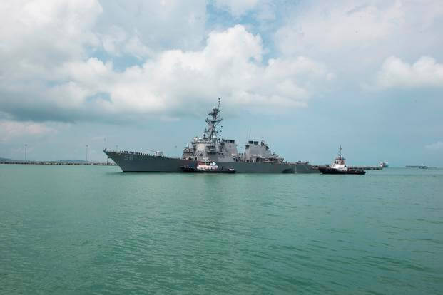 Tugboats assist the USS John S. McCain (DDG 56) at it steers towards Changi Naval Base in Singapore following a collision with the merchant vessel Alnic MC east of the Straits of Malacca and Singapore on Aug. 21, 2017 (U.S. Navy photo/Joshua Fulton)