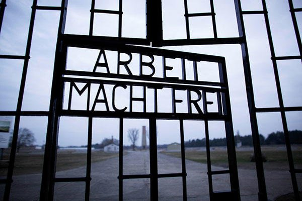 "This Jan. 27, 2012, file photo shows the words ""Arbeit Macht Frei"" (Work Sets You Free) at the main entrance of the Sachsenhausen Nazi concentration camp on the international Holocaust remembrance day in Oranienburg, Germany. Markus Schreiber/AP"